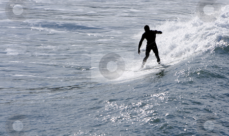 Surfing stock photo, A man riding a wave with his surfing board by Ivan Montero