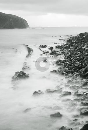 Shore stock photo, Calm image of the rocks in the sea shore by Ivan Montero