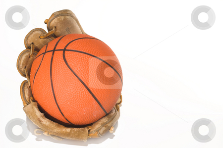 Basketball Glove stock photo, A basketball in an old baseball mitt. by Robert Byron