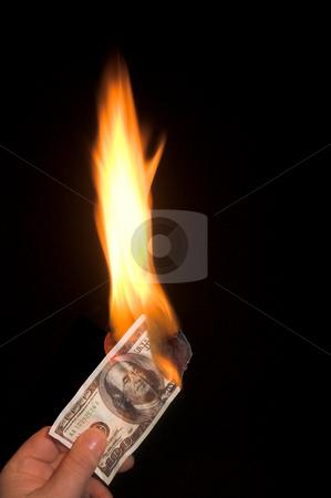 Burning 100 Dollar Bill stock photo, A one hundred dollar bill on fire.. by Robert Byron