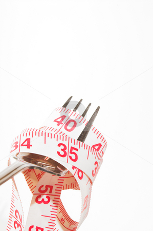 Weight Loss Concept stock photo, Weight Loss Concept - A tailor's tape on a fork. by Robert Byron