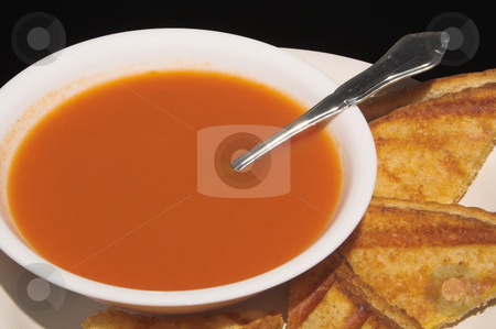 Soup and Sandwich stock photo, A grilled cheese sandwich and a bowl of tomato soup. by Robert Byron
