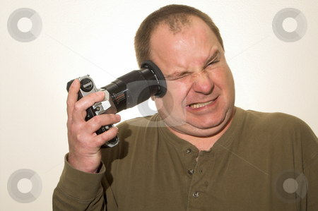 Suicidal Photographer stock photo, A photographer shooting his own head off. by Robert Byron