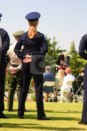 Parade Rest stock photo, Police woman standing at parade rest. by Henrik Lehnerer