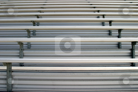 Bleachers stock photo, Bleachers in a stadium or school for the fans. by Henrik Lehnerer