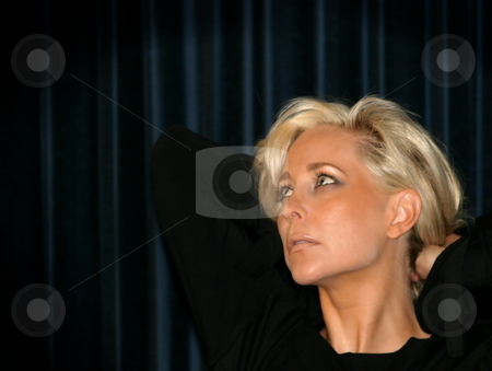 Woman looking away stock photo, Portrait of a beautiful young woman with blond hair by Henrik Lehnerer