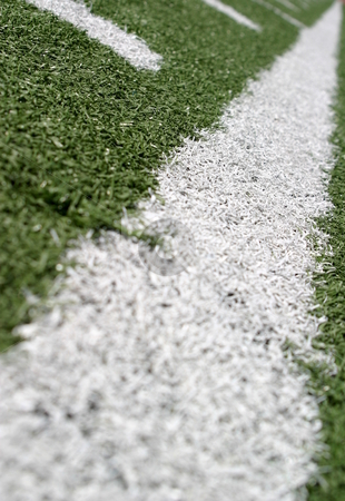 Football Lines stock photo, Green football field with large yard markers. by Henrik Lehnerer