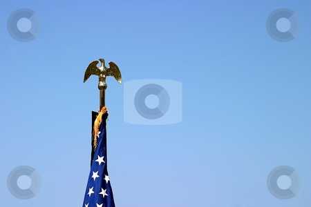 USA Flag Top stock photo, The top of a USA flag with a golden eagle by Henrik Lehnerer