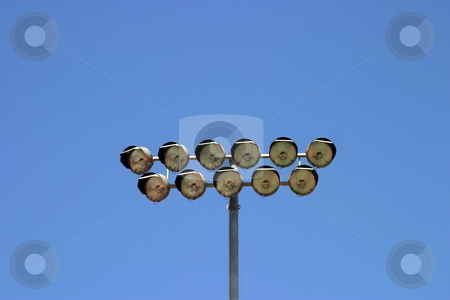 Floodlight  stock photo, Floodlight from a football stadium with the sky as a background. by Henrik Lehnerer