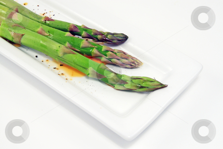 Asparagus stock photo, Asparagus on white with sundried tomato dressing by Jack Schiffer