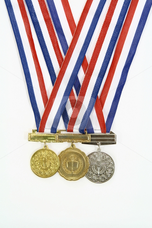 Medals stock photo, Three different medals from various scholastic awards by Jonas Marcos San Luis