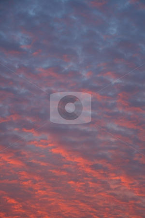 Mackerel clouds at  sunset stock photo, Mackerel clouds with shades of red, orange and blue at sundown by Jonas Marcos San Luis