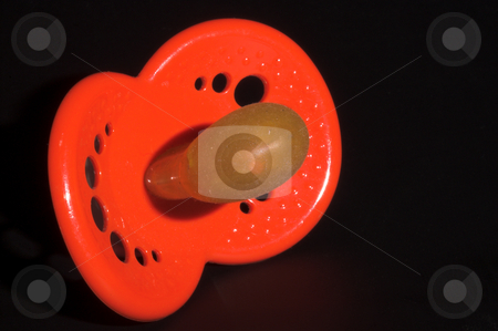 Pacifier stock photo, A close-up image of a baby's pacifier by Robert Byron