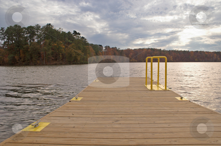 Pier at Sunset stock photo, A boat dock or pier at sunset. by Robert Byron