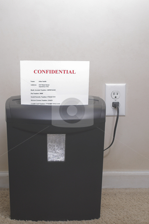 Shredder - Identity Theft Concept stock photo, A shredder with confidential information - Identity theft concept. by Robert Byron