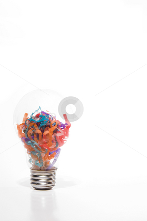 Party Bulb stock photo, A light bulb filled with paper confetti. by Robert Byron