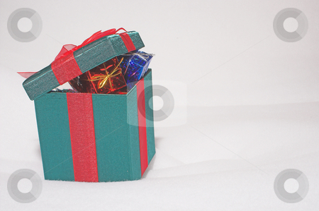 Christmas Present Gift Boxes in the Snow stock photo, A set of colorful seasonal Christmas present gift boxes. by Robert Byron
