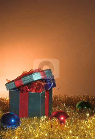 Christmas Presents stock photo, A set of Christmas gifts inside a large wrapped box. by Robert Byron