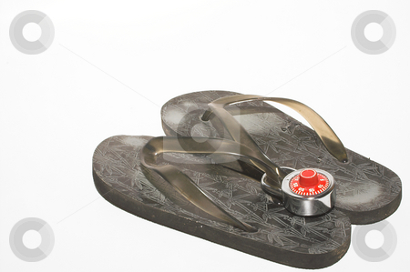 Flip Flop Security stock photo, A padlock on a pair of flip flops. by Robert Byron
