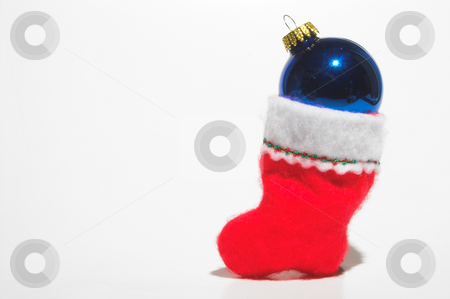 Christmas Stocking stock photo, A Christmas stocking loaded with a Christmas ornament. by Robert Byron