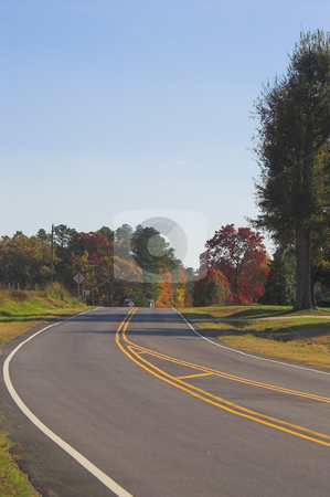 Country Road stock photo, A country road on a sunny fall afternoon. by Robert Byron