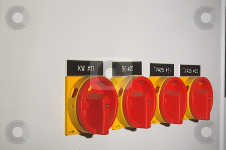 Industrial Power Safety Switches stock photo, A row of industrial on off power safety switches. by Robert Byron