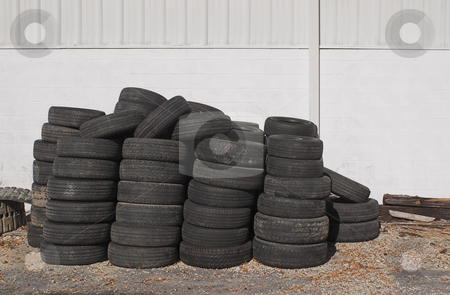 Old Tires stock photo, A oile of old tires outside of an auto shop. by Robert Byron