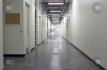 Industrial Hallway stock photo, A long hallway in an industrial facility. by Robert Byron