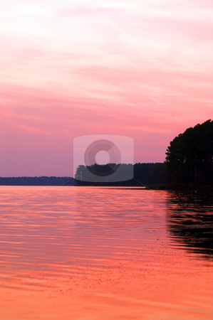 Sunset Lake stock photo, A lake just after sunset with the reflection of a beautiful orange sky. by Robert Byron