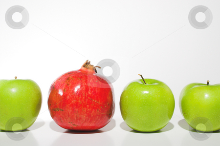 Apples and a Pomegranate stock photo, Several Granny Smith apples and a delicious pomegranate. by Robert Byron
