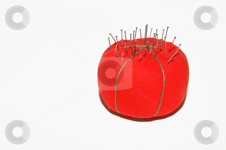Pin Cushion stock photo, Straight pins in a pin cushion used for sewing. by Robert Byron