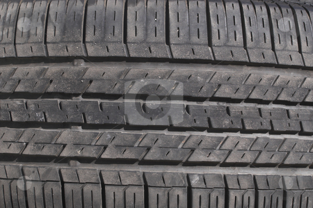 Car Tire stock photo, A close-up image of an automobile tire. by Robert Byron