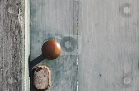 Antique Doorknob stock photo, An antique doorknob on an antique door of a historic building. by Robert Byron