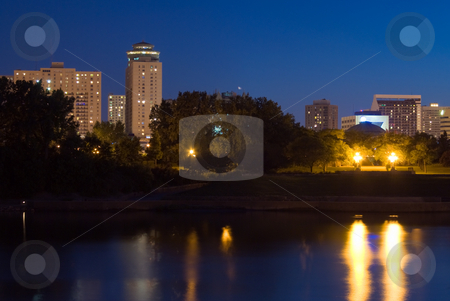 Winnipeg Skyline stock photo, A view of a Winnipeg skyline from across a river at night by Richard Nelson