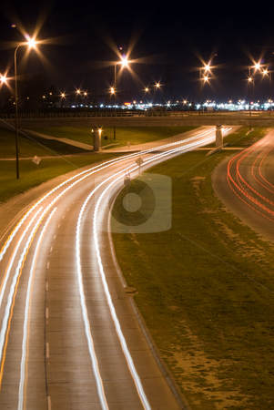 Night Traffic stock photo, Traffic blurs on a busy highway, shot at night by Richard Nelson