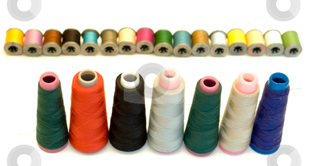 Spools of Thread stock photo, Various sizes and colors of thread isolated on a white background by Richard Nelson