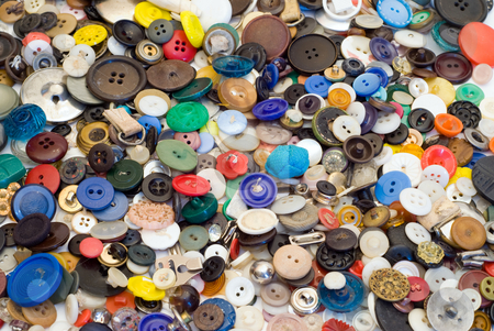 Background of Buttons stock photo, Background of multicolored sewing buttons of assorted sizes by Richard Nelson
