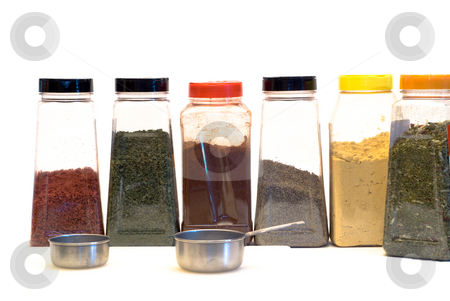 Spices stock photo, An assortment of spices and measuring cups, isolated on a white background by Richard Nelson