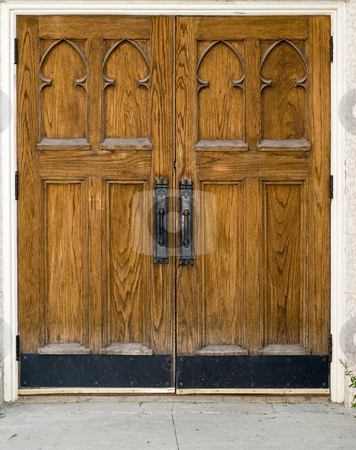 Wooden Doors stock photo, A set of large closed wooden doors by Richard Nelson