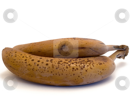 Frozen Bananas stock photo, Two frozen bananas isolated on a white background by Richard Nelson