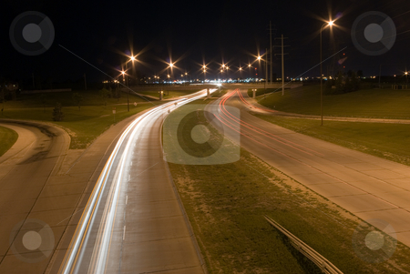 Traffic at night stock photo, Traffic on a highway shot on a dark night by Richard Nelson
