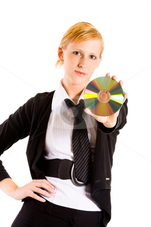 Business woman with a CD stock photo, Friendly business woman presenting a compact disk. Focus is on the CD by Frenk and Danielle Kaufmann