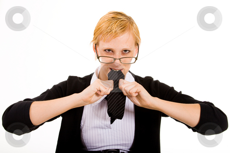 Eating my necktie out of frustration stock photo, Frustrated business woman is eating her necktie by Frenk and Danielle Kaufmann