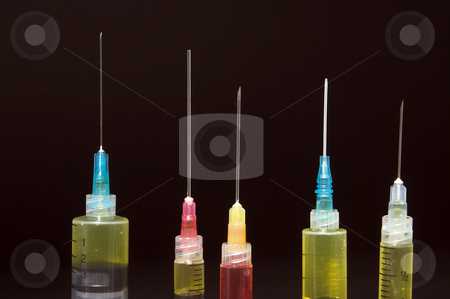 Medical Syringes stock photo, A set of sharp medical pharmaceutical syringes. by Robert Byron