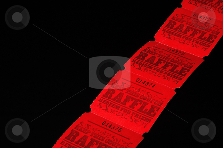 Raffle Tickets stock photo, A strand of bright red rafflle tickets. by Robert Byron