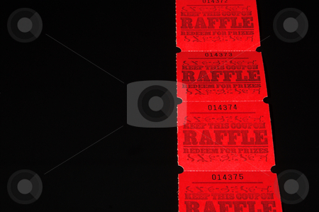 Raffle Tickets stock photo, A strand of bright red raffle tickets. by Robert Byron