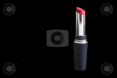 Lipstick stock photo, A small tube of expensive red lipstick. by Robert Byron