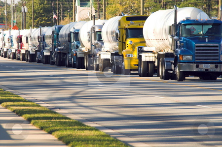 Convoy stock photo, A convoy of diesel freight tanker trucks. by Robert Byron