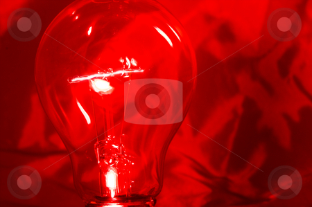 Light Bulb stock photo, An incandescent light bulb with a burning filament. by Robert Byron