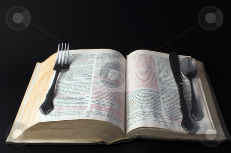 Food for Thought stock photo, A bible and silverware: Concept of feeding the soul. by Robert Byron